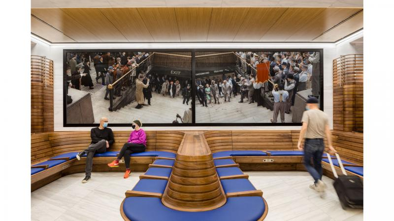 LIRR/Amtrak waiting room by Rockwell Group at Moynihan Train Hall with photographs by Stan Douglas