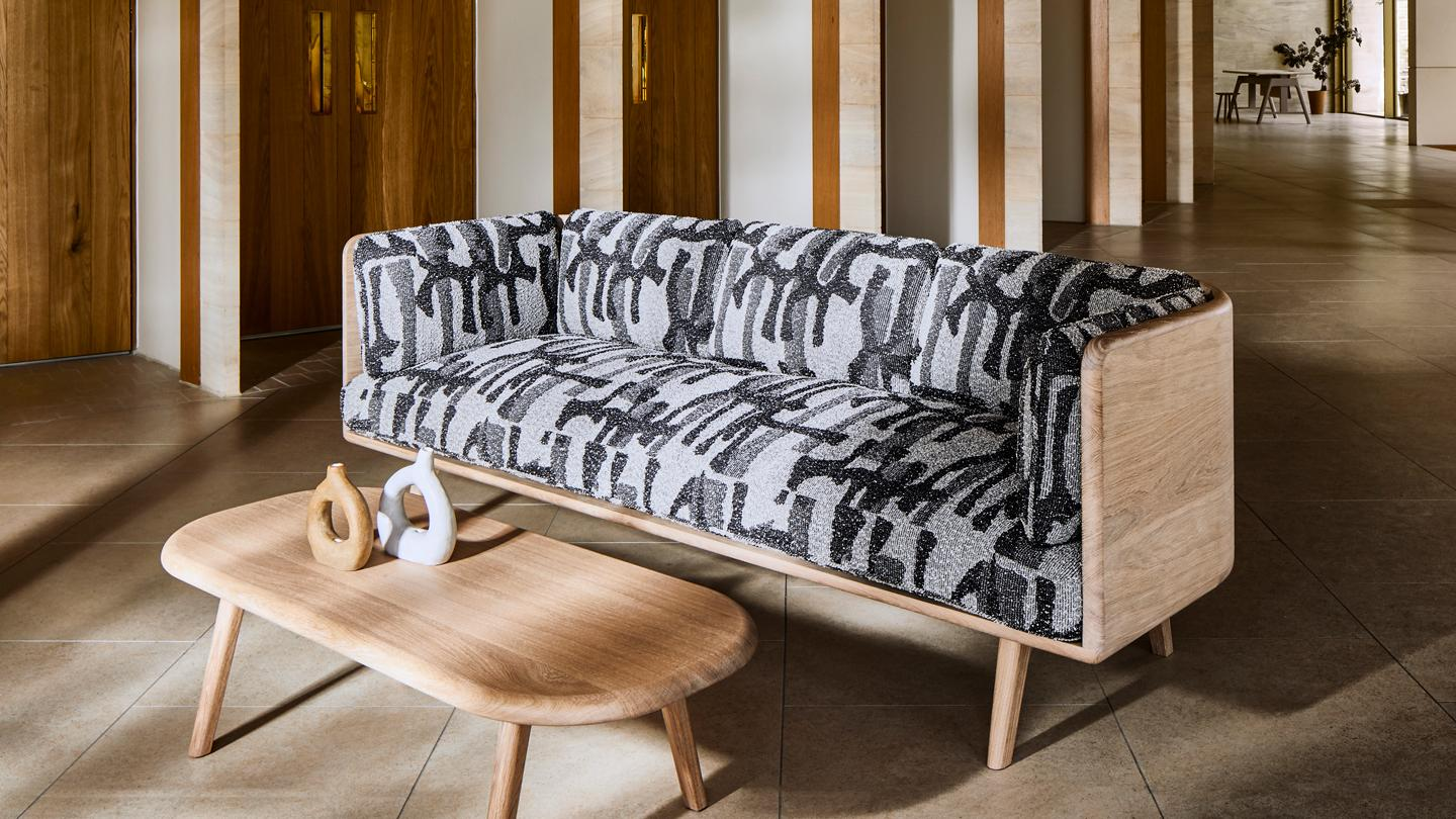 Subtle yet complex in detail, the sofa exemplifies Benchmark's skilled woodworking.