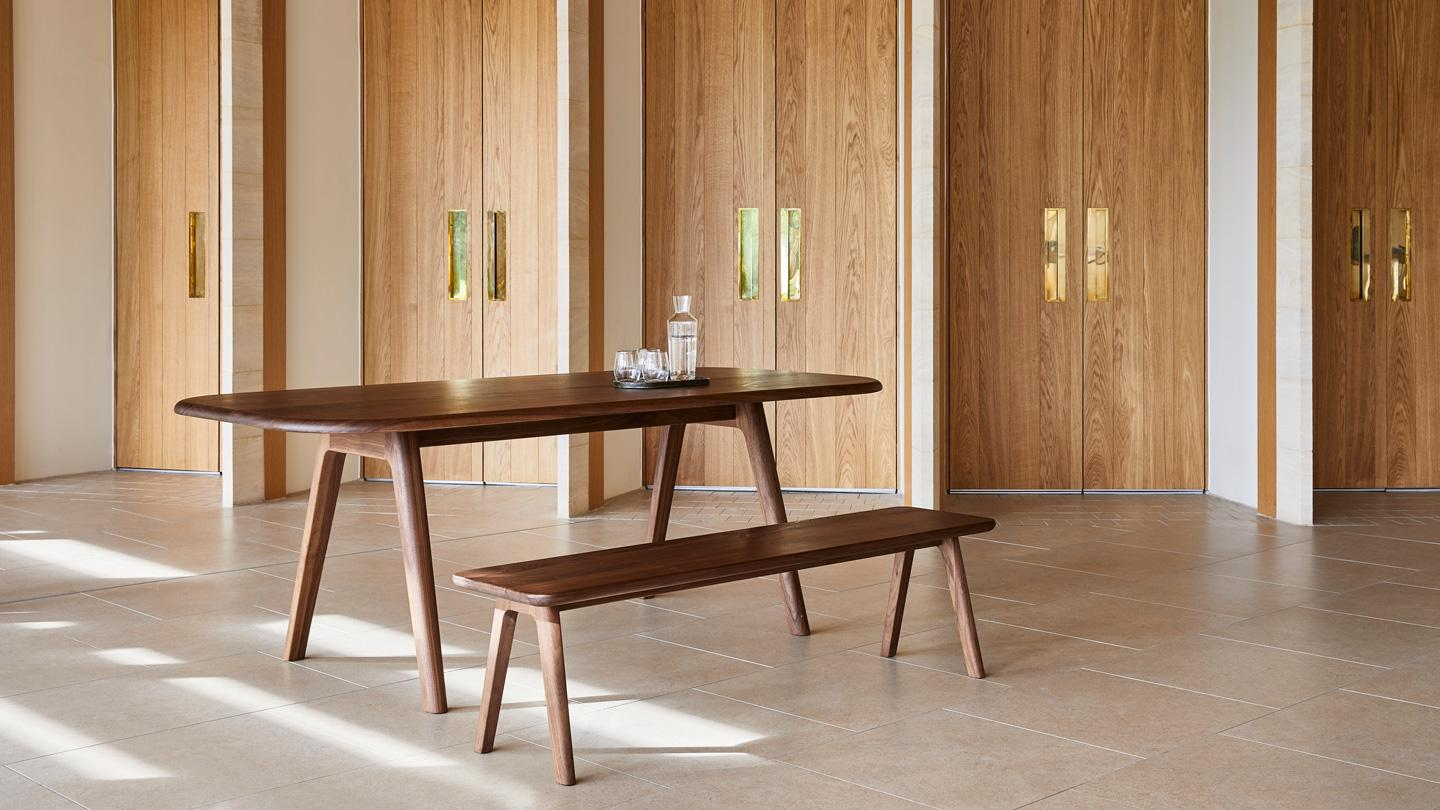 Tables feature the collection's signature rounded forms for tactility and comfort.