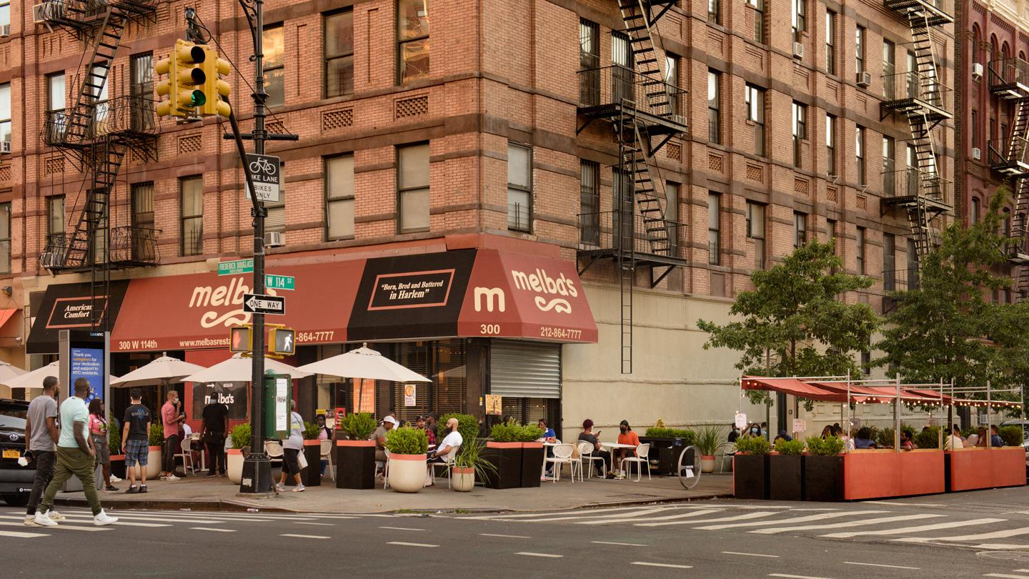 Street view of DineOut NYC and Melba's restaurant in Harlem