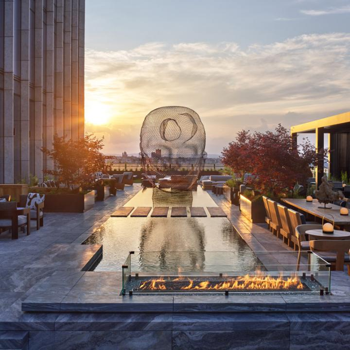 Outdoor terrace and reflecting pool at Equinox Hotel designed by Rockwell Group in New York City